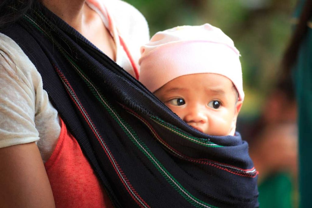 Woman-Carrying-Baby