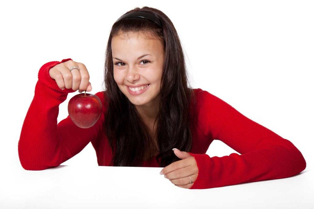 Smiling-Woman-Holding-Red-Apple