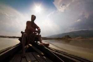 Bangladeshi-Man-Sitting-on-Boat