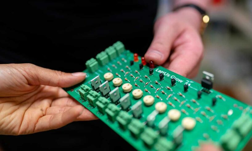 Taiwan-semiconductor-Engineers-Holding-Circuit-Board