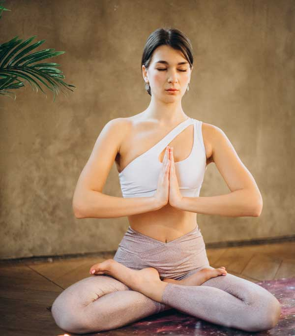 Woman-Practicing-Yoga