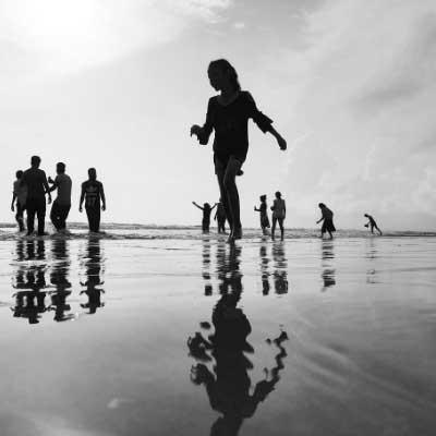 Woman Walking on the Seashore