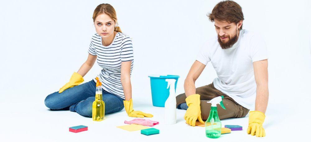 Young Couple Washing Floors